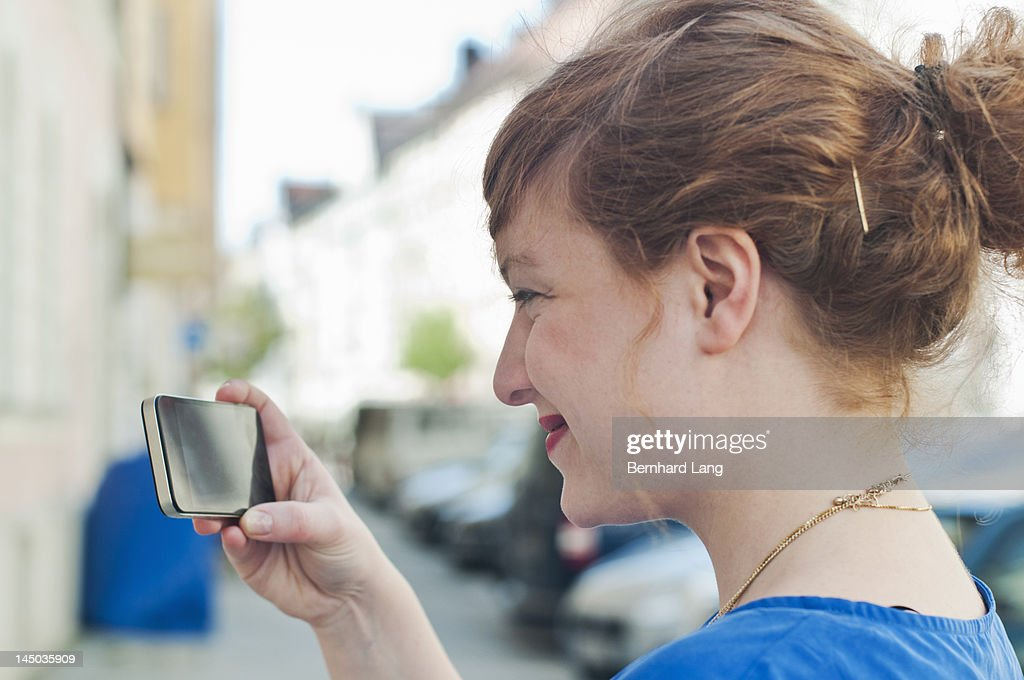 Young woman looking on smartphone : Stock Photo