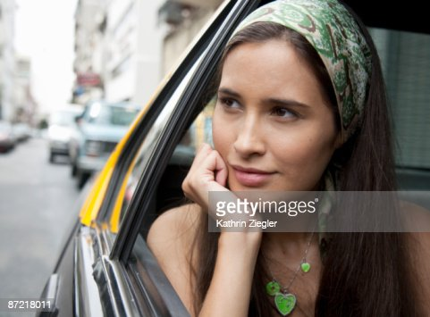 young woman looking out of taxi window : Foto stock