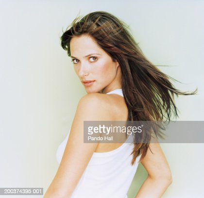 Young Woman Looking Over Shoulder Portrait Stock Photo ...