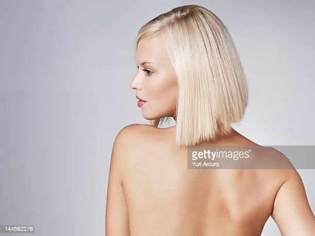 Young woman looking over shoulder, studio shot