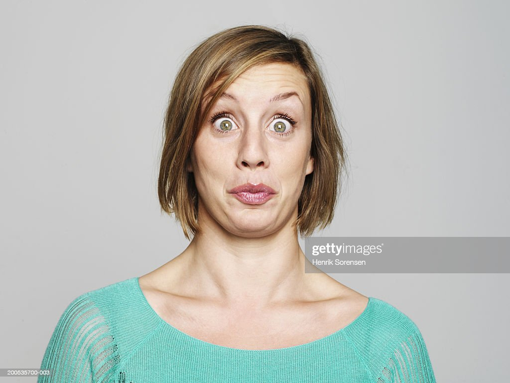 Young woman looking surprised, portrait