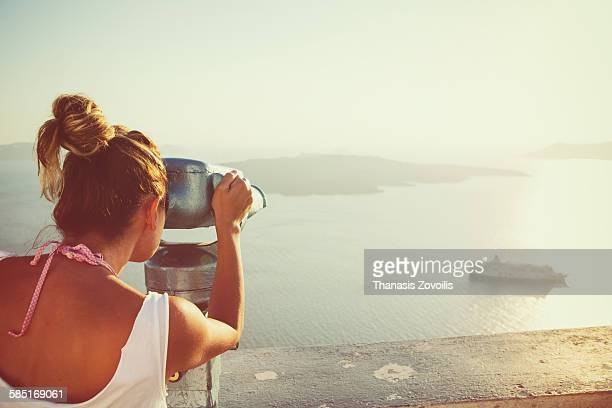 Young woman looking the Caldera in Santorini