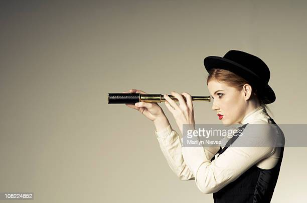 Young Woman Looking Through Telescope