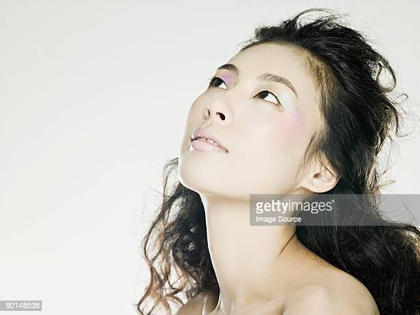 Young woman looking up