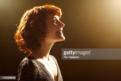 Young woman looking up, smiling. : Stock Photo