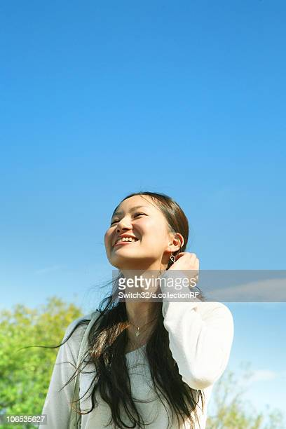 Young Woman Looking Up the Sky