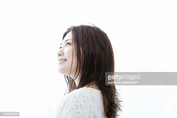 Young woman looking up, Tokyo Prefecture, Honshu, Japan