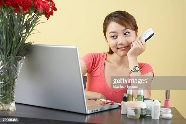 A young woman looks for beauty products online.