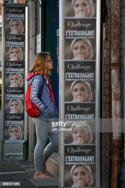 A young woman looks into the window of a paper shop in the town center on February 15 2017 in Henin Beaumont France The former mining town in...