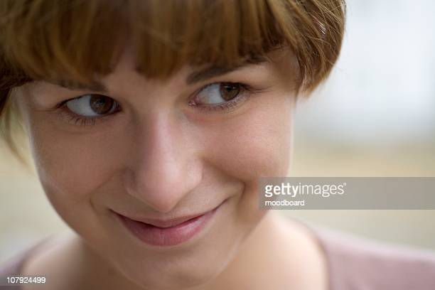 Young woman looks sideways