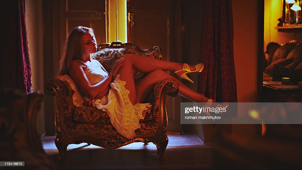 Young woman lounging in the european interior