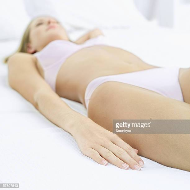 Young woman lying down in her underwear
