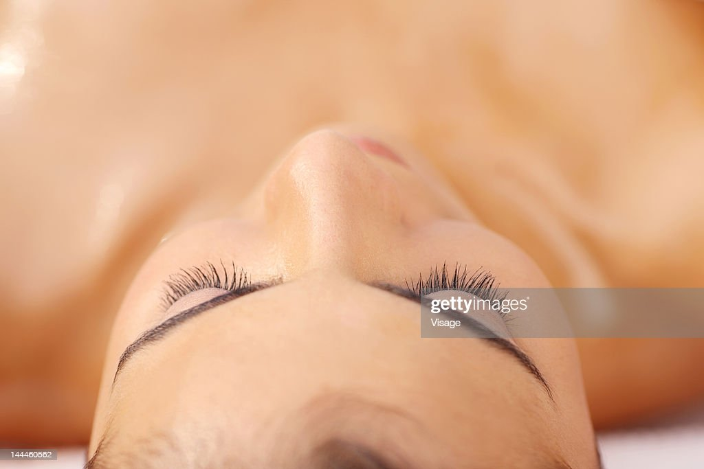 Young woman lying down,close up : Stock Photo