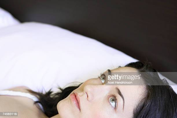 Young woman lying in bed, close-up