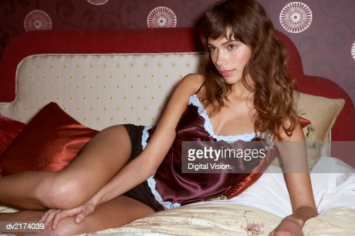 Young Woman Lying in Bed : Stock Photo