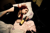 young woman lying drunk in her bed  similar images:      [url=file_closeup.php?id=7030666][img]file_thumbview_approve.php?size=1&id=7030666[/img][/url] [url=file_closeup.php?id=7030596][img]file_thumb