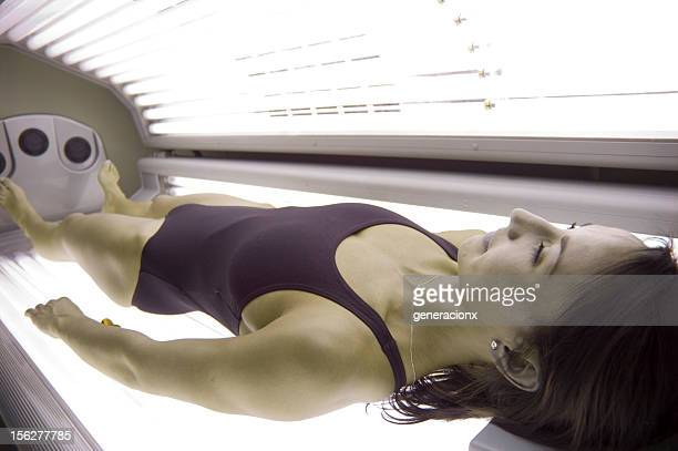 Young Woman Lying in Tanning Bed