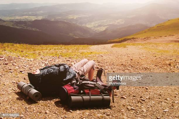 Young woman lying on backpack