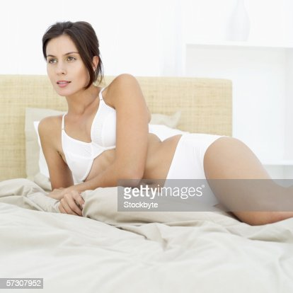 little girl lying on the bed in her knickers