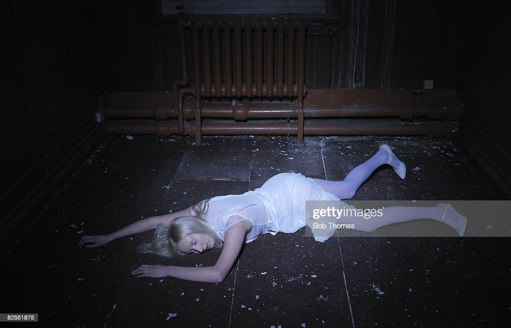 Young Woman Lying on Floor : Stock Photo
