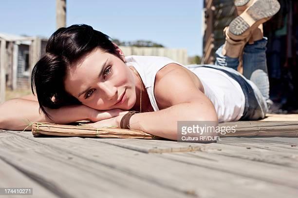 Young woman lying on front sunbathing