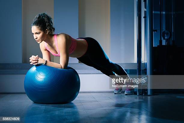 Young woman lying on gymnastic ball