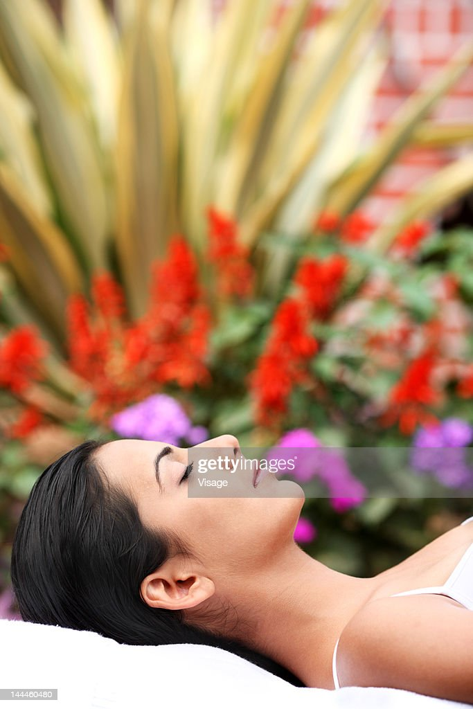 Young woman lying on massage table : Stock Photo