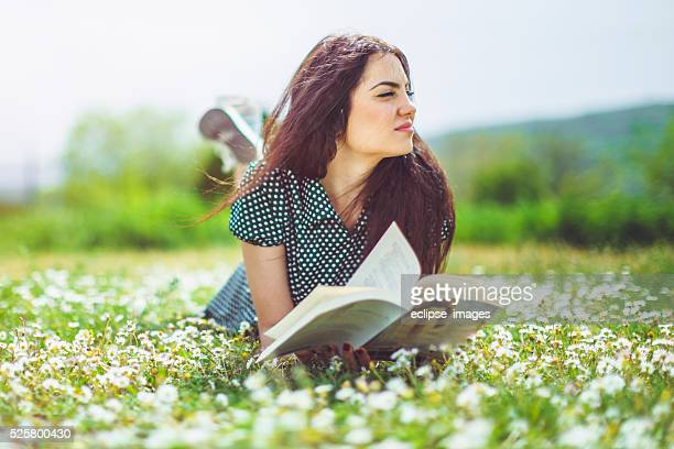 young woman lying on meadow