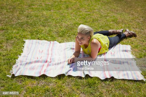 Young Woman Lying On Rug On Park Grass Stock Photo Getty