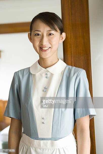 Young woman maid, smiling, portrait, front view