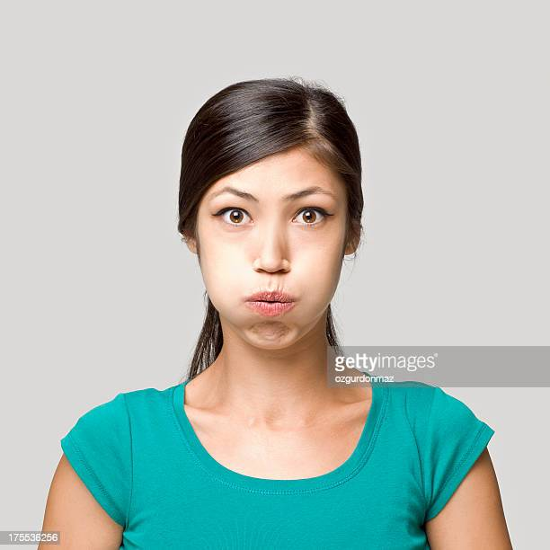 Young woman making a boring face expression