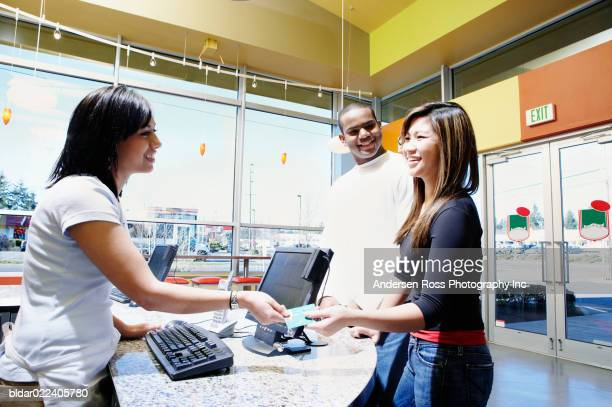 Young woman making a credit card payment