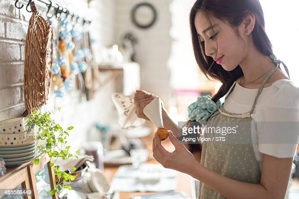 young woman making cookie in kitchen