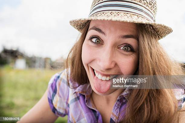 Young woman making faces.