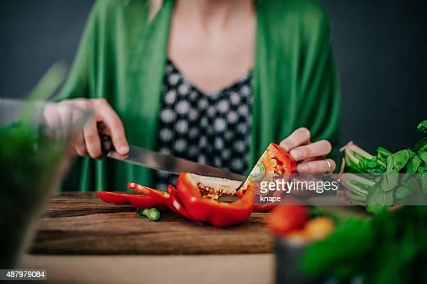 Young woman making fresh salad