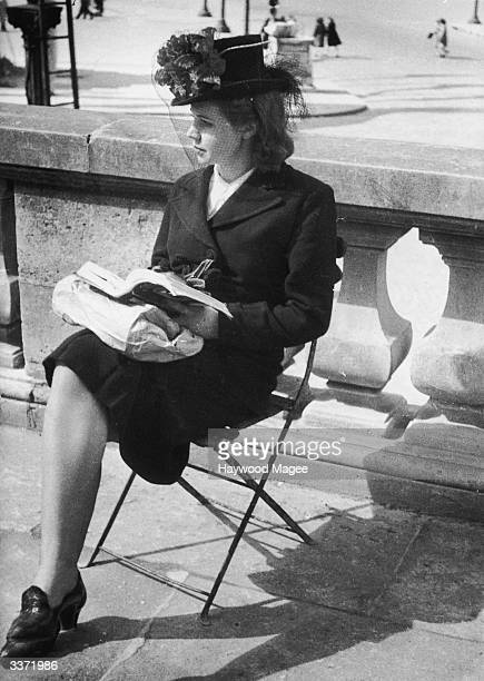 A young woman marks VE Day in Paris with a moment of solitude 8th May 1945 Original Publication Picture Post 1984 Paris Celebrates pub 19th May 1945