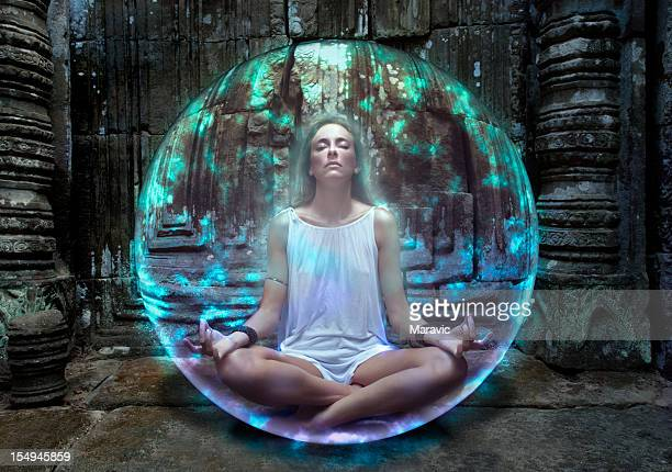 Young woman meditates inside protective bubble