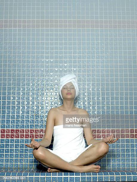 Young woman meditating at spa