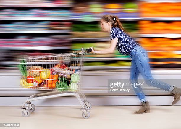 Young woman messing around in supermarket