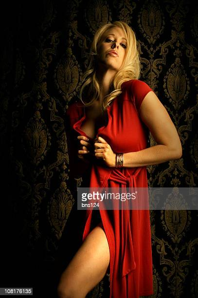 Young Woman Model Posing and Wearing Red Dress