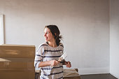 Young woman moving house and decorating