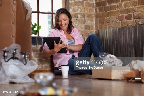young woman moving into a new apartment stock photo getty images. Black Bedroom Furniture Sets. Home Design Ideas