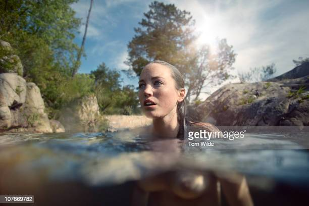 Young woman naked in water