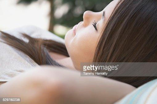 Young woman napping : Bildbanksbilder