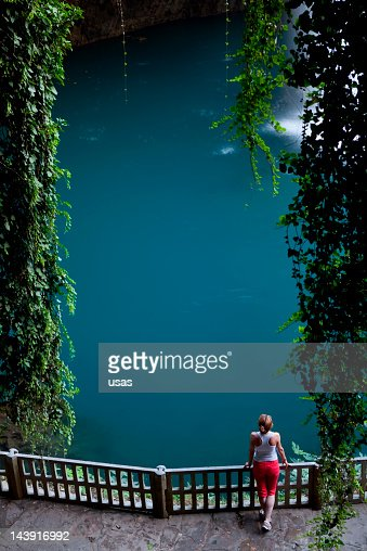 Young Woman near the Waterfall with ivy : Stock Photo