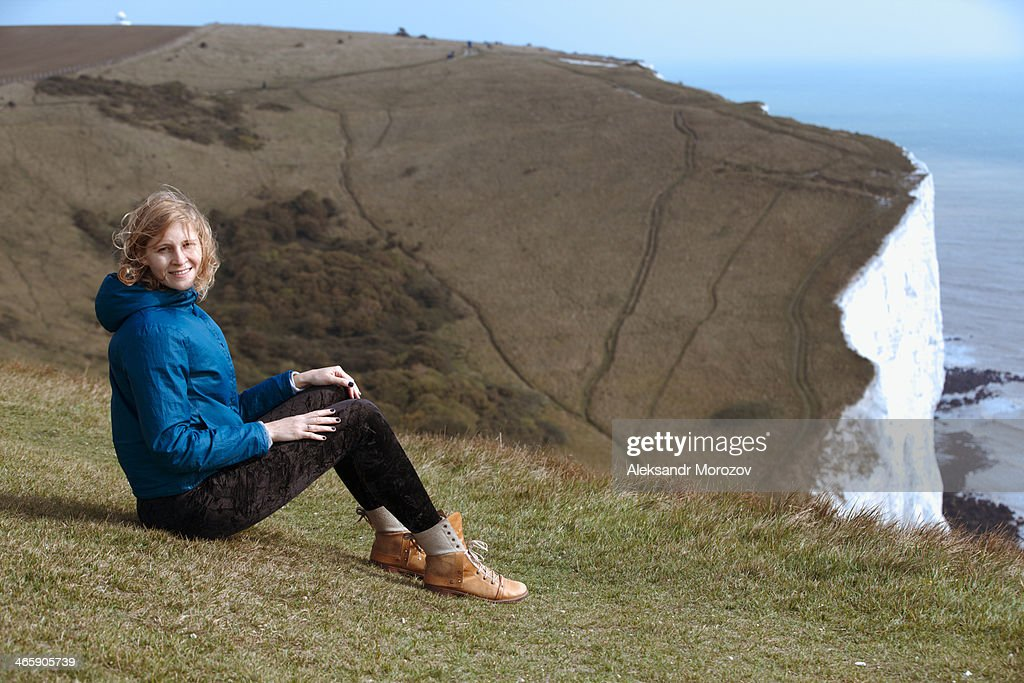 Young woman near white cliffs