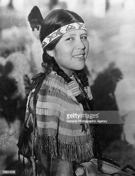 A young woman of a Native American tribe with her hair in plaits