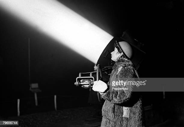 19th January 1943 An ATS girl manning a searchlight at a 'Home Counties' location