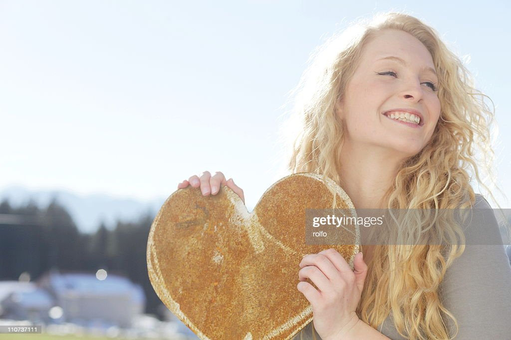 Young woman old heart : Stock Photo