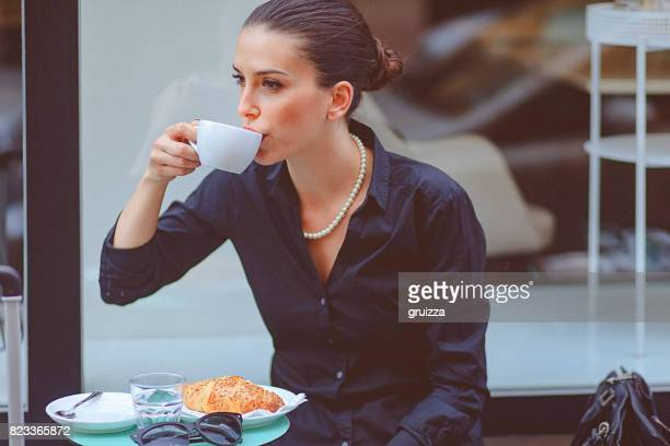 Young woman on a coffee break at cafe